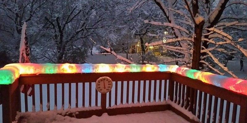Christmas lights encased in snow