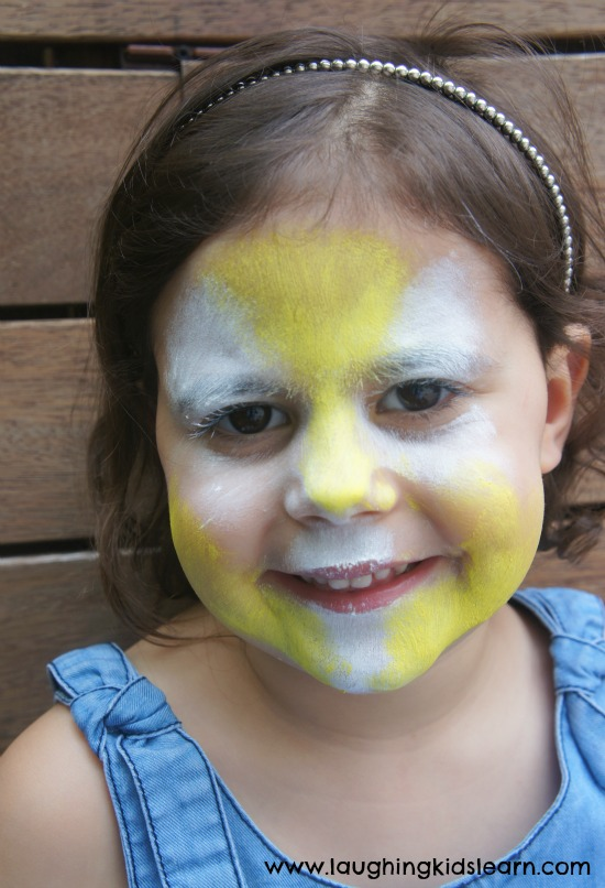 Simple face painting design of a lion   Laughing Kids Learn yellow paint