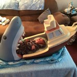 Uncle Builds 'Jaws' Crib for Infant Nephew That Makes It Look Like He's in a Boat Being Eaten by a Shark