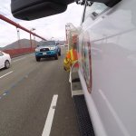 A Nerve-Wracking Video of a Worker in a Moving Truck Expertly Placing Lane Markers by Hand on the Golden Gate Bridge