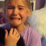 An Emotional Young Girl Cries Tears of Joy When She's Surprised With a New Kitten