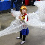 Giant Invisible Jet Made Out of Balloons That Wraps Around a Little Girl Dressed as Wonder Woman