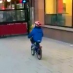 Little Boy Distracted by a Racy Strip Club Ad on Van Says 'Ooh La La!' and Crashes Bicycle Into a Wall