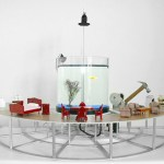 A Goldfish Controlled Hammer That Rotates Around a Semicircle Smashing Tiny Furniture