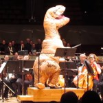 A T-Rex Conducts the Colorado Symphony as They Play John Williams' Jurassic Park Theme Song