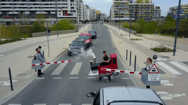 recc81mi-gaillard Prankster Rémi Gaillard Stops Traffic as a Little Choo Choo Train That Needs to Safely Cross the Road Random