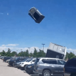 A Violent Windstorm Sends Porta Potties Flying Into the Air Spewing Their Contents Onto the Crowd