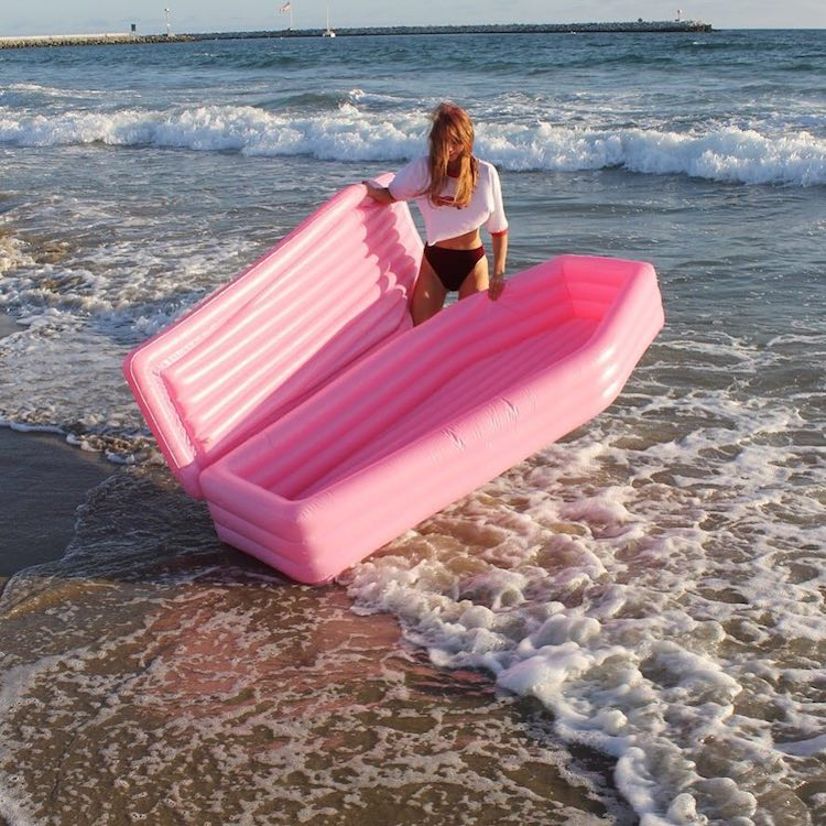 pom-pom-float A Hilarious Inflatable Pink Lidded Pool Float That Can Work as a Stylish Coffin Should the Need Arise Random