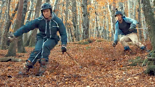 Leaf-Skiing1 Avid Adventurers Skillfully Ski Down a Hillside Forest That's Fully Blanketed With Autumn Leaves Random