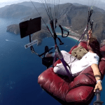 Turkish Paraglider Watches Television on a Comfy Couch While Soaring High in the Sky