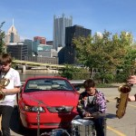 Pittsburgh Horn Trio Seamlessly Incorporates Car Alarm Into Badass Instrumental Inspired by Too Many Zoos