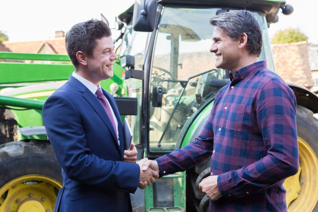 Businessman and farmer shaking hands