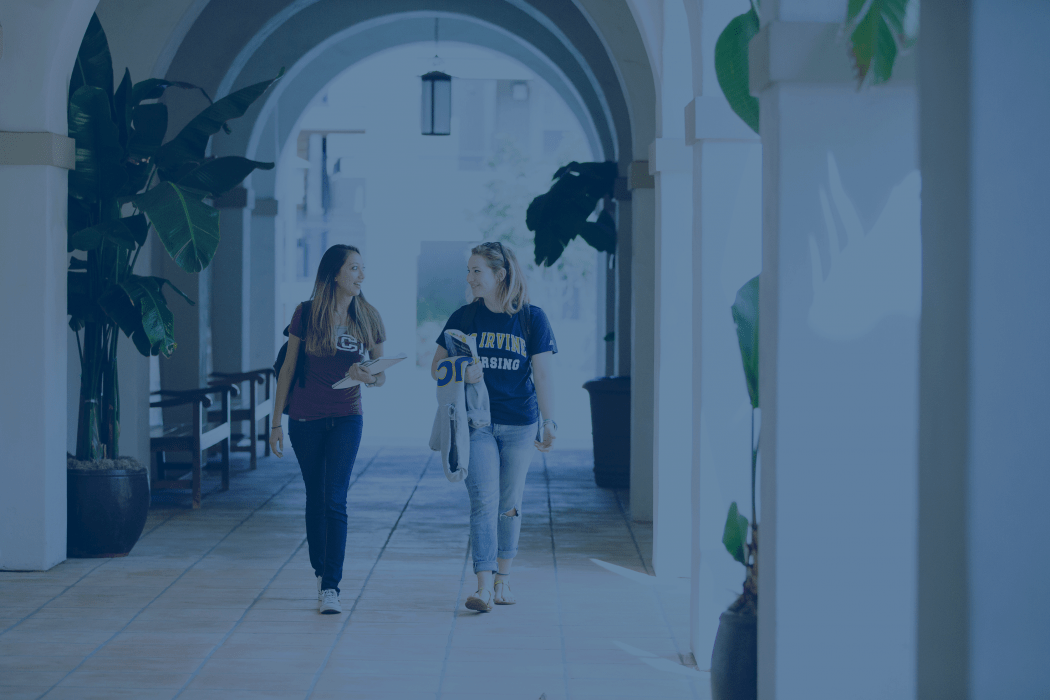 Two female students walking on campus