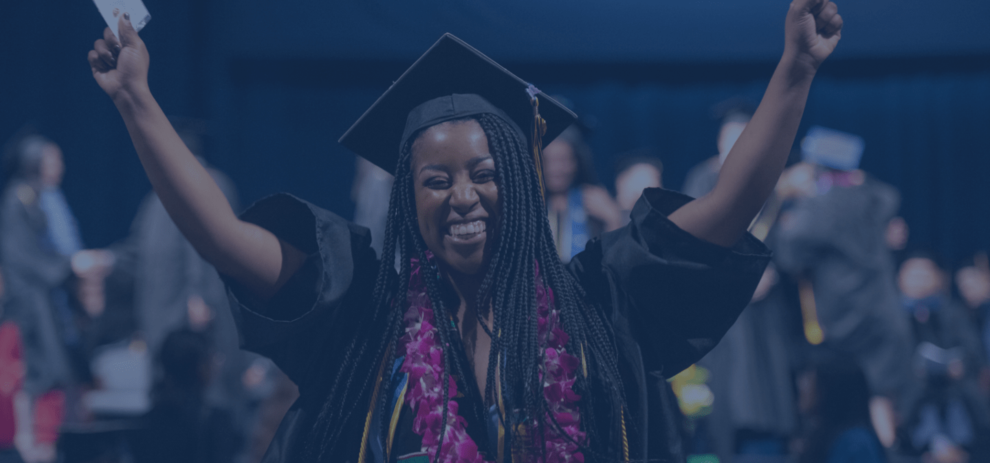 female student celebrating at UCI commencement