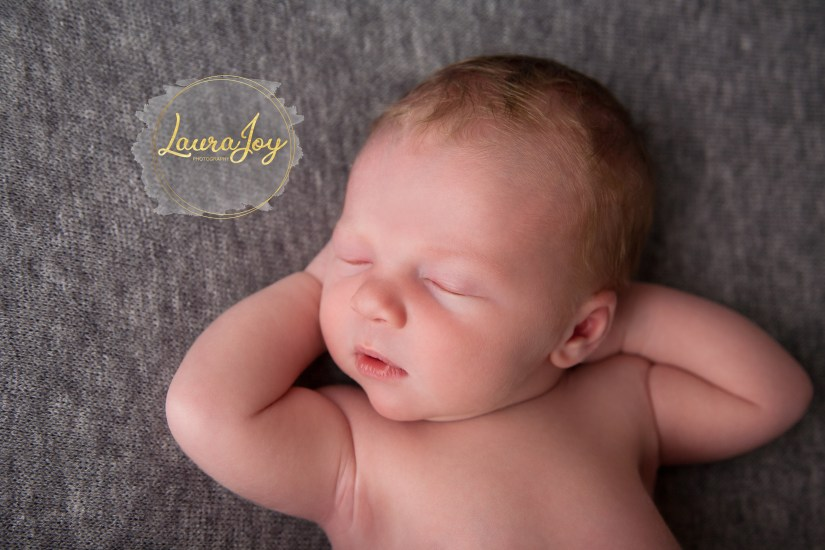 Newborn baby George relaxing at Laura Joy Photography. Newborn Photographer, Glasgow.