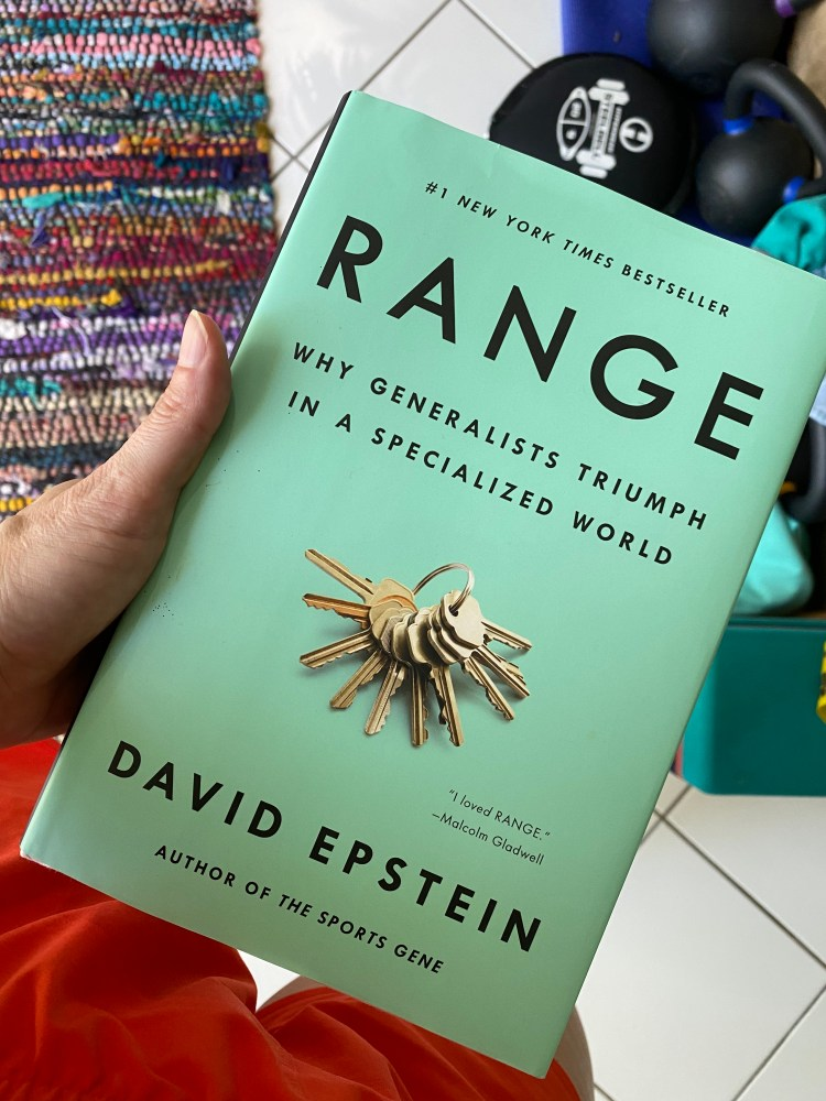 Image of Laura holding the book Range by David Epstein. This book is a must-read for anyone who wants to understand how being trained in multiple disciplines makes you more effective overall. A great read for yoga teachers, movement professionals, or folks who are changing careers!