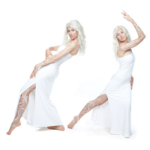 Laüra Hollick dancing as white spirit. Photo by Kevin Thom. Hair, makeup and body painting by Sue Upton