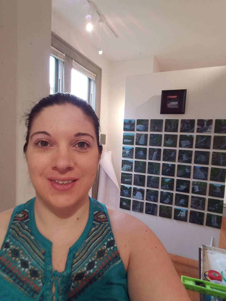 Photo of Laura Jaen Smith in front of 50 NY Waterfalls Collection Summer Mosaic 2018