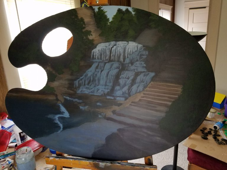 Work in Progress of Escape to Paradise by Laura Jaen Smith. Giant palette-shaped acrylic painting of waterfall in Cascadilla Gorge Ithaca NY