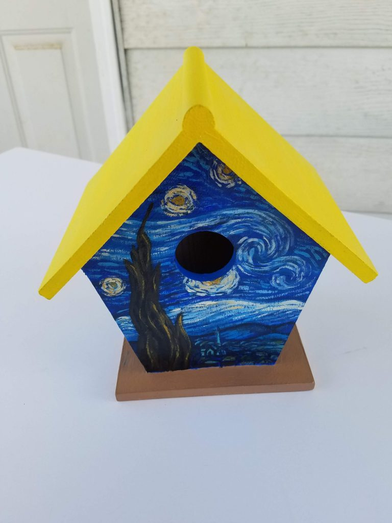 Van Gogh Birdhouse. Squared birdhouse with yellow roof, tan base. Hand-painted scene inspired by Starry Night