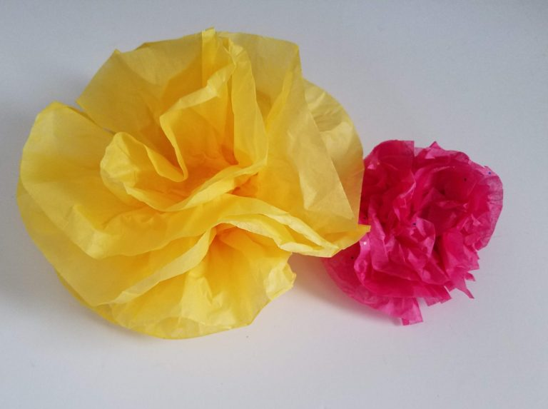 Crafting Paper flowers. Finished flowers - big yellow, smaller hot pink