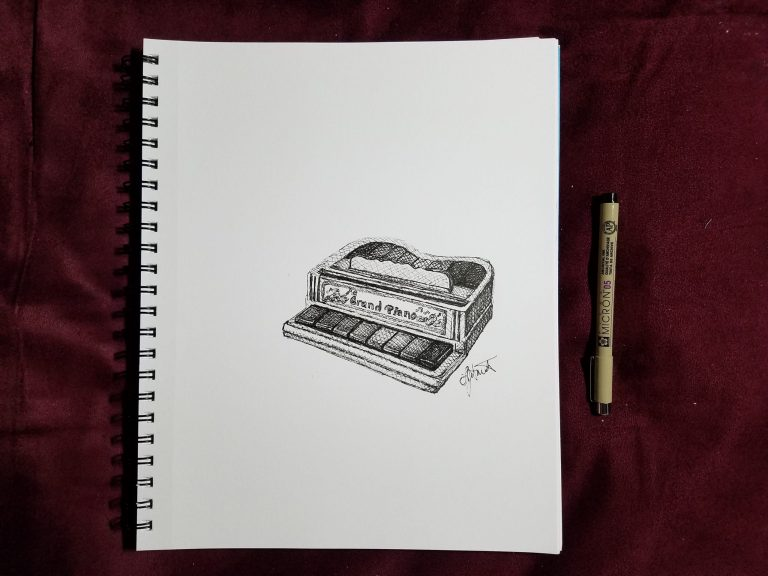 Grand Piano by Laura Jaen Smith. Sketchbook view of ink drawing of toy piano with ink pen next to it