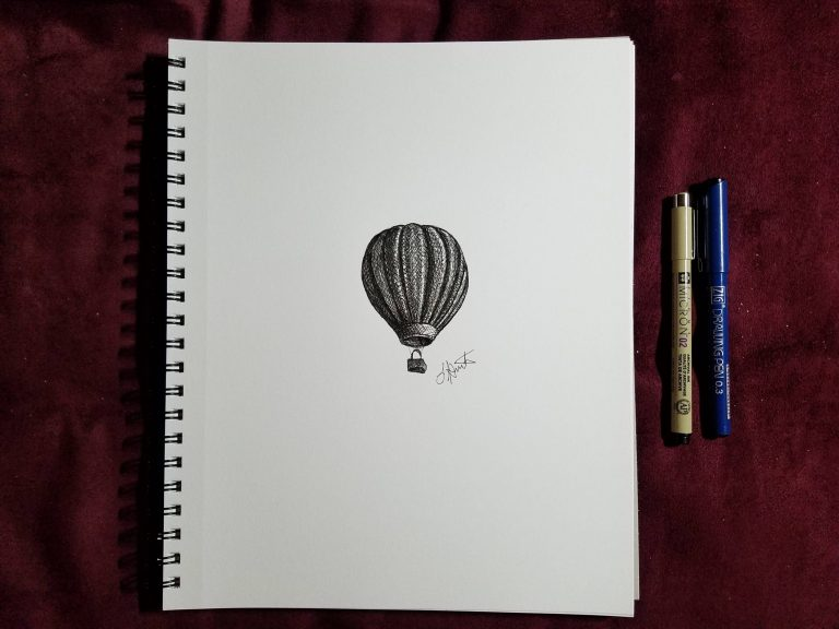 Up, Up & Away by Laura Jaen Smith. Sketchbook view of ink drawing of hot air balloon with ink pens