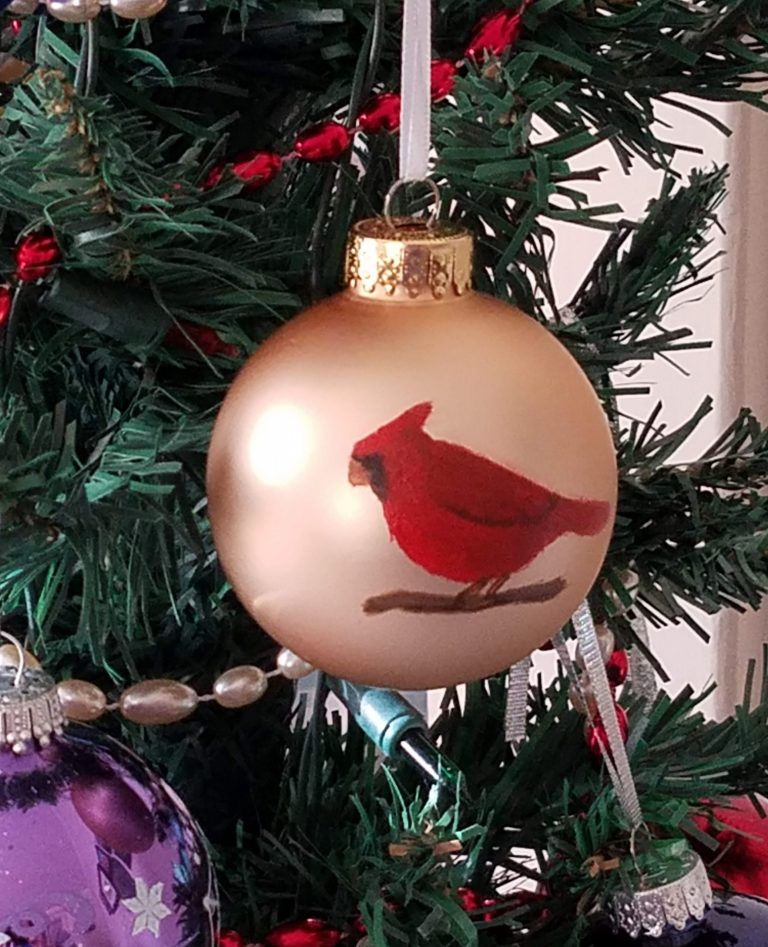 Gold ornament with red cardinal