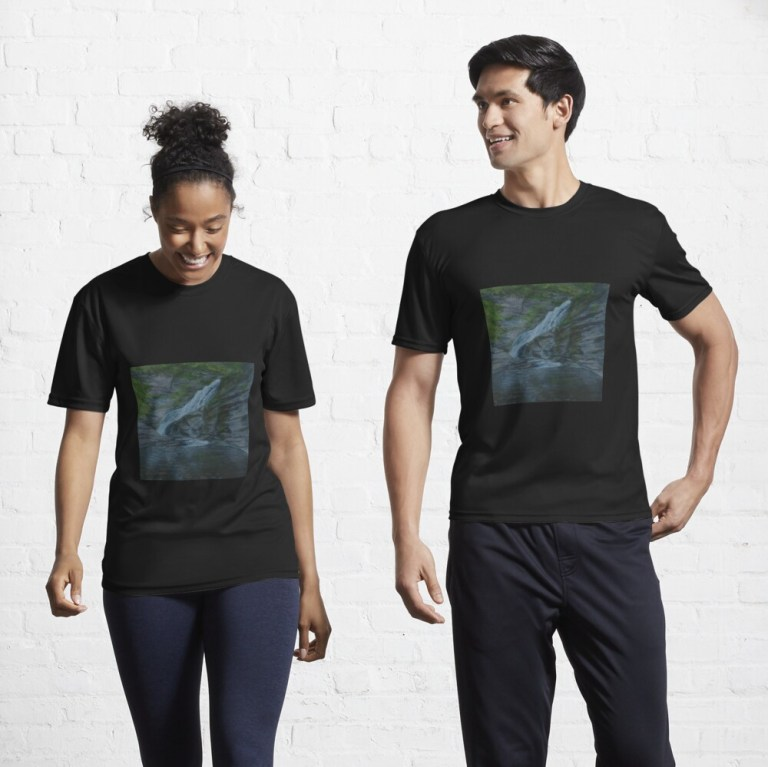 Two persons with black tee shirts with image of Lucifer Falls painting by Laura Jaen