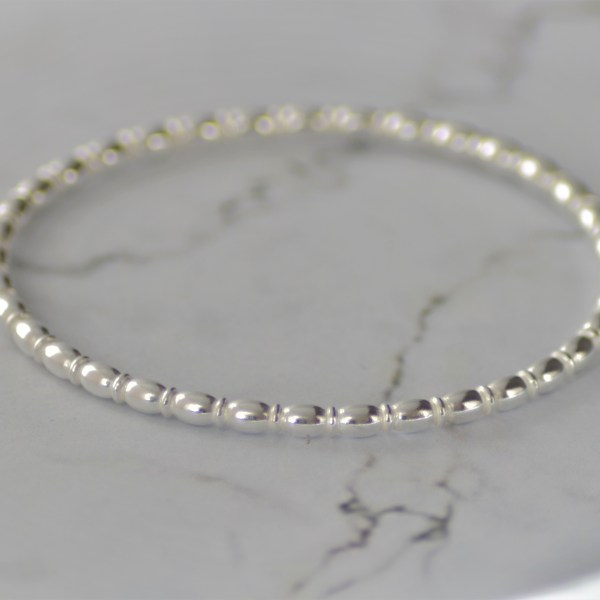 Oval beaded solid silver ladies bangle by Laura Llewellyn Desgin