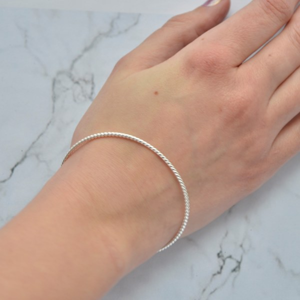 Silver twisted ladies stacking bangle by Laura Llewellyn Design