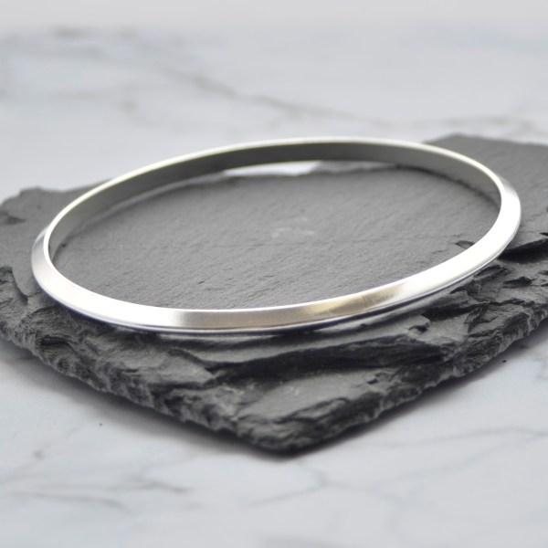Solid silver ladies triangular bangle by Laura Llewellyn Design