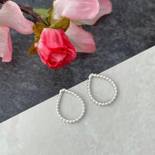 Small silver tear drop stud earrings