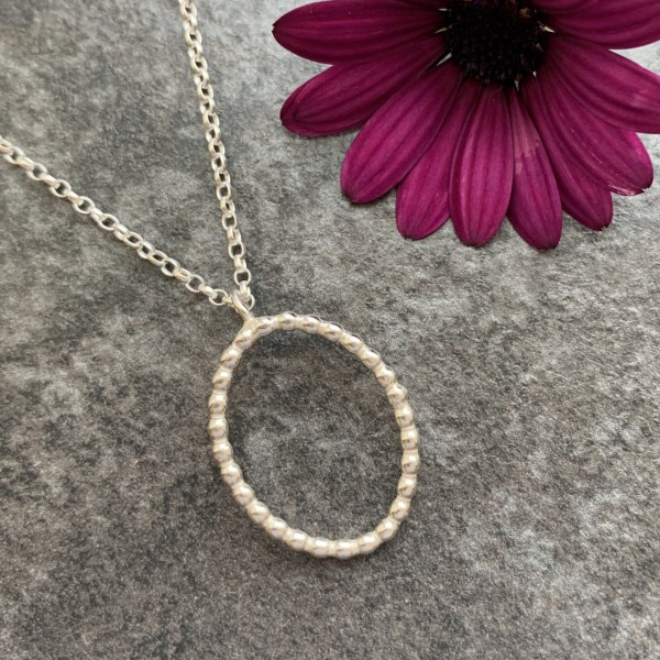 Oval beaded silver pendant