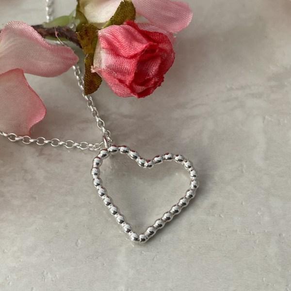 Silver heart pendant; handmade jewellery by Laura Llewellyn Design