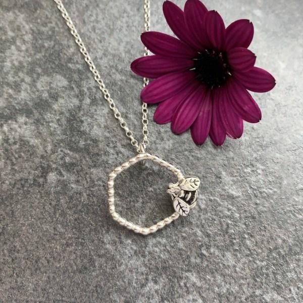 Silver honeycomb bee pendant