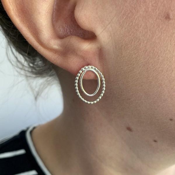 Modelling oval silver stud earrings