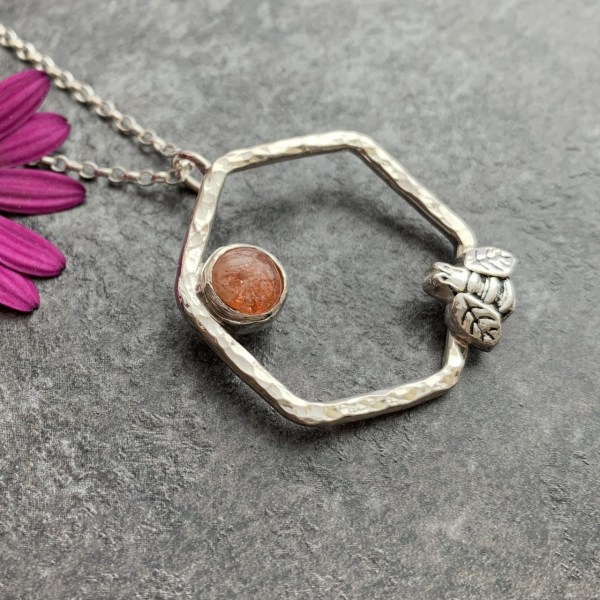 Silver honeycomb and bee pendant