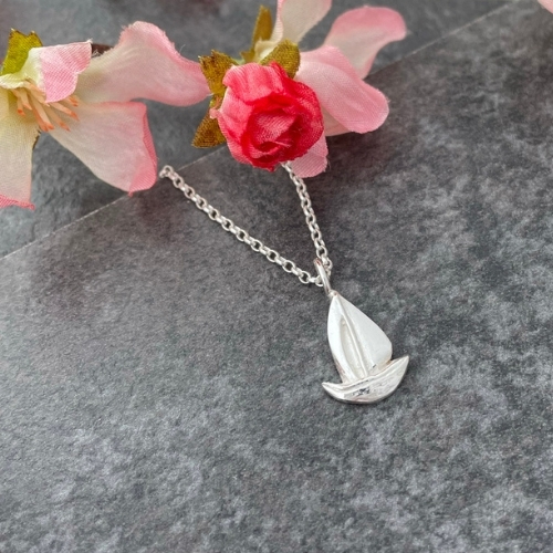 Silver sailboat charm pendant