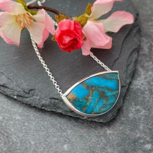 Turquoise gemstone pendant set in a handmade silver pendant
