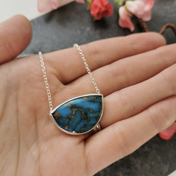 Turquoise copper gemstone pendant in handmade silver pendant by Laura Llewellyn Design Hallmarked in London