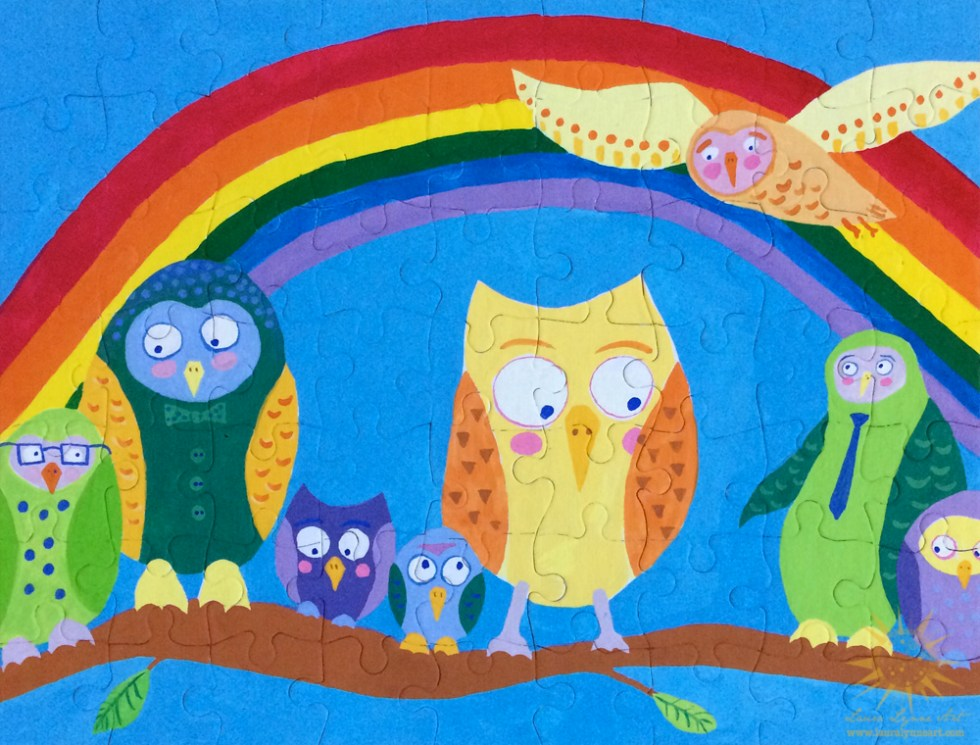 hand painted puzzle with owls on a branch and a rainbow behind