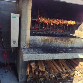 Chickens being roasted on the fire at the Adler restaurant on the mountain