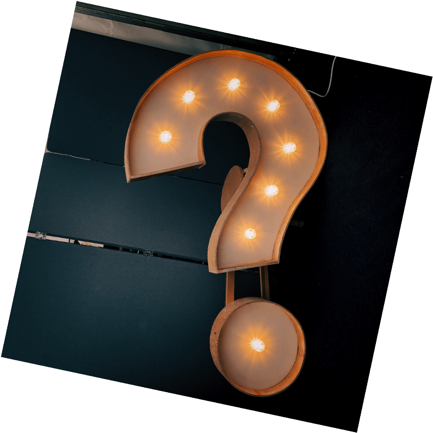 A light up sign in the shape of a question mark.
