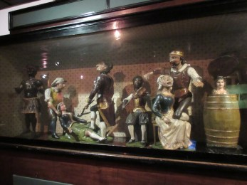 A barrel organ with wooden figures which, when animated, enact various grisly teeth-pulling operations.