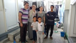 Here we are with the father and two sons of the family we visited
