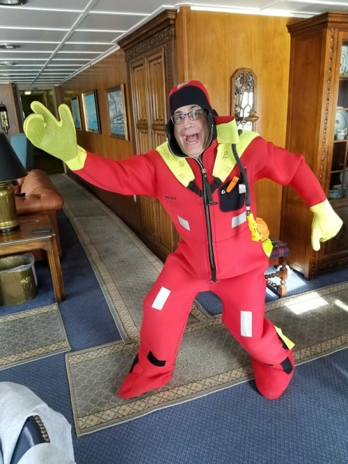 Randy Salas tries on the emergency immersion suit on the Paul R. Tregurtha freigher in advance of a safety drill.