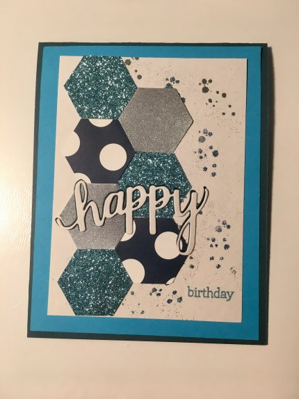 birthday card in glitter blues created using hexagon punch and embossed textures