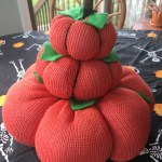 DIY stack of pumpkins from orange sweater