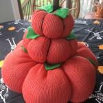 DIY stack of pumpkins from orange sweater